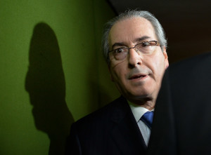The president of the Chamber of Deputies Eduardo Cunha heads to the Senate to launch the impeachment trial of President Dilma Rousseff in the National Congress in Brasilia, April 18, 2016.  The National Congress' Lower House approved the continuation of Rousseff's impeachment and the Senate case also approve the president can lose the warrant.  / AFP PHOTO / ANDRESSA ANHOLETE